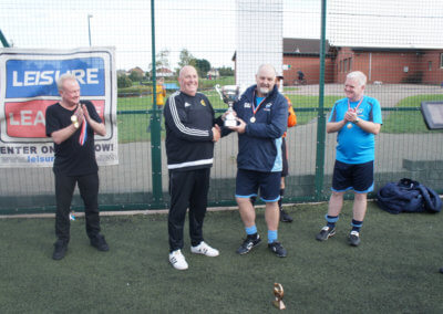 Presenting the winning Trophy